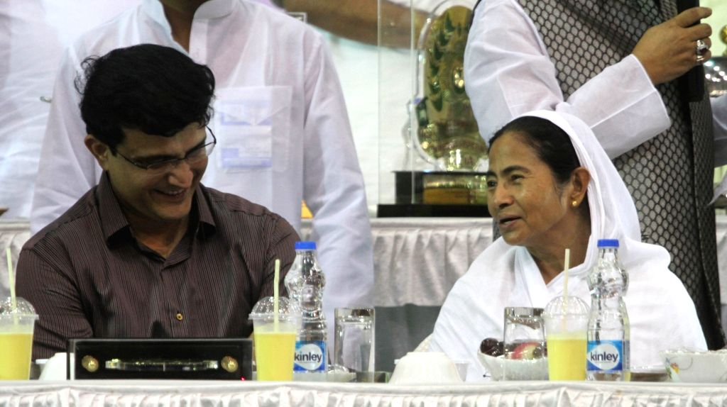 West Bengal Chief Minister Mamata Banerjee and CAB President Sourav Ganguly during an Iftaar party organised by Mohammedan Sporting Club in Kolkata on July 4, 2016. - Mamata Banerjee and Sourav Ganguly