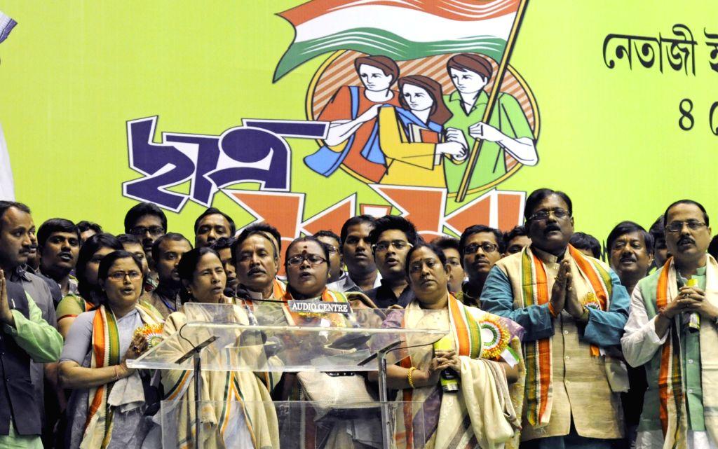West Bengal Chief Minister Mamata Banerjee and Trinamul Congress activists singing national anthem  during workshop of Trinamul Congress in Kolkata on Feb. 4. - Mamata Banerjee