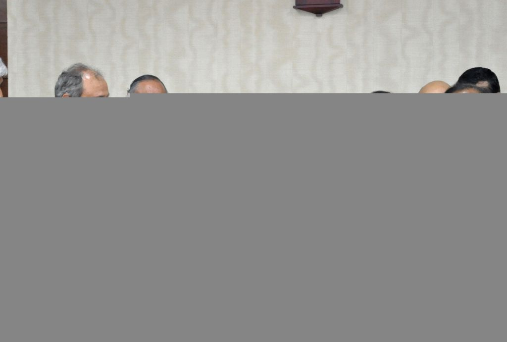 West Bengal Chief Minister Mamata Banerjee and Finance Minister Amit Mitra with Tata Metaliks Limited MD Sanjiv Paul during a programme organised to sign a Memorandum of Understanding with ... - Mamata Banerjee