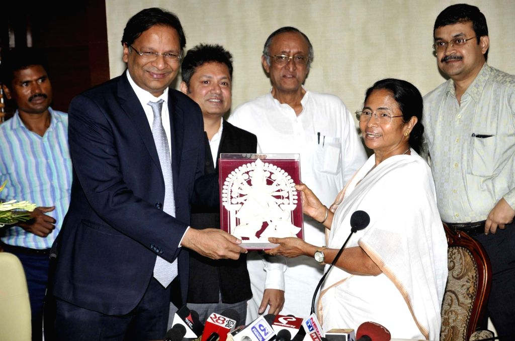 West Bengal Chief Minister Mamata Banerjee and Finance Minister Amit Mitra with SpiceJet CMD Ajay Singh during a press conference at Nabanna in Howrah, near Kolkata on Sept 19, 2016. - Mamata Banerjee and Ajay Singh