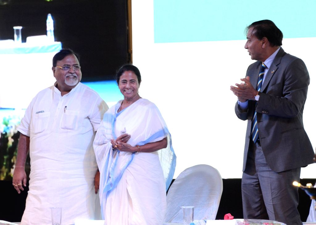 West Bengal Chief Minister Mamata Banerjee and Education Minister Partha Chatterjee with ArcelorMittal Chairman and CEO Lakshmi N Mittal during a programme organised to start the first ... - Mamata Banerjee and Partha Chatterjee