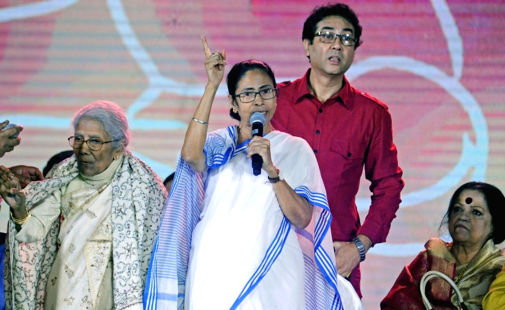 West Bengal Chief Minister Mamata Banerjee and singer Sandhya Mukherjee during the inauguration of 'Bangla Sangeet Mela 2019' in Kolkata on Dec 4, 2019. - Mamata Banerjee and Sandhya Mukherjee