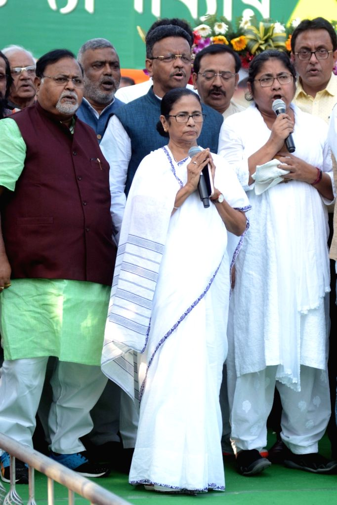 West Bengal Chief Minister Mamata Banerjee and state cabinet ministers Partha Chatterjee and Firhad Hakim during a progranmne organised to pay tributes to Dr B.R. Ambedkar on his 64th death ... - Mamata Banerjee and Partha Chatterjee