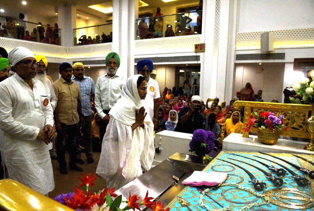 West Bengal Chief Minister Mamata Banerjee at Gurdwara Sant Kutiya where a Sikh procession arrived from Nankana Sahib, Pakistan - in Kolkata on Aug 29, 2019. - Mamata Banerjee
