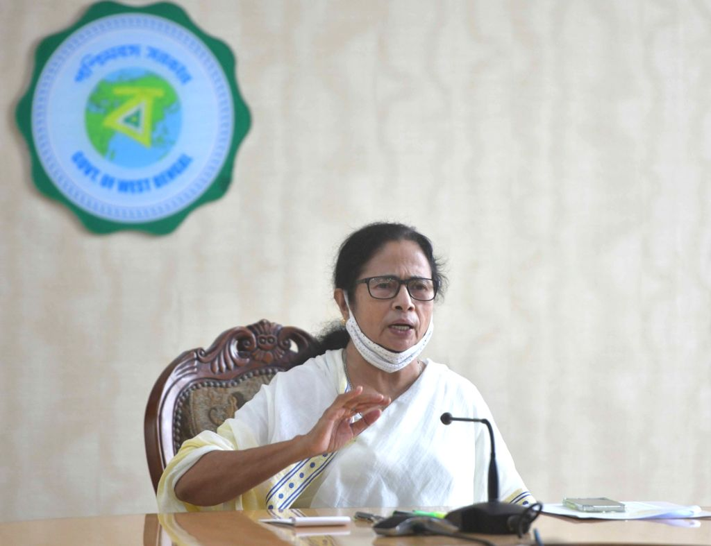 "West Bengal Chief Minister Mamata Banerjee at a video conference with Indian Minister of Home Affairs Amit Shah about super cyclone ""Yash"" at Nabanna at Howrah  in Kolkata   24 ... - Mamata Banerjee and Affairs Amit Shah"