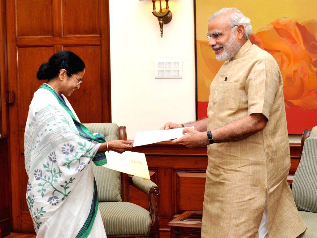 West Bengal Chief Minister Mamata Banerjee calls on Prime Minister Narendra Modi, in New Delhi on Aug 12, 2015. - Mamata Banerjee and Narendra Modi