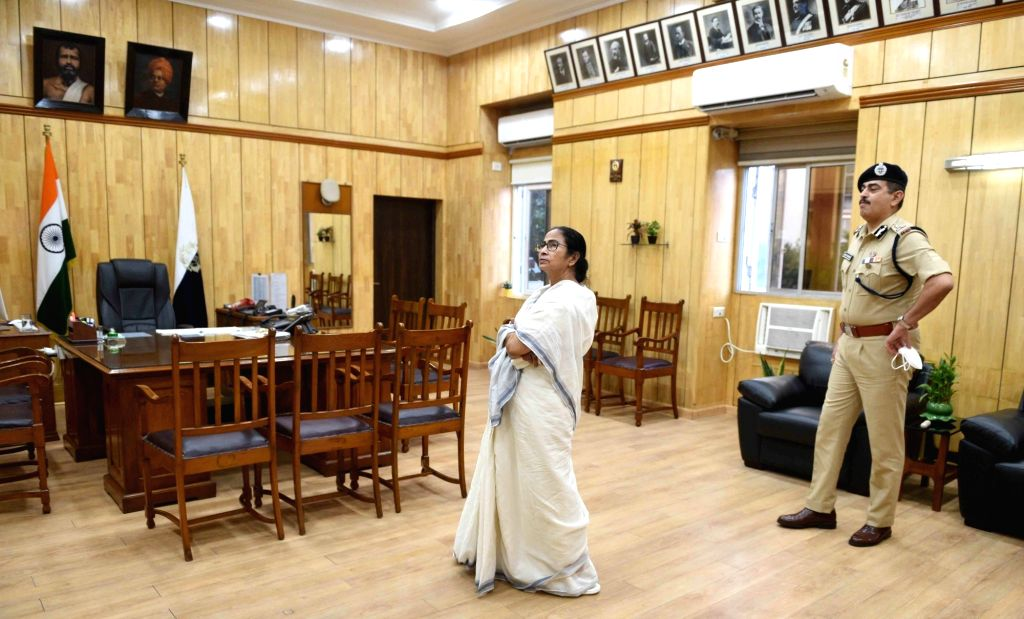 West Bengal Chief Minister Mamata Banerjee during her visit to Kolkata police headquarters at Lalbazar to review the preparedness to tackle the situation during COVID-19 pandemic, on Day 7 ... - Mamata Banerjee