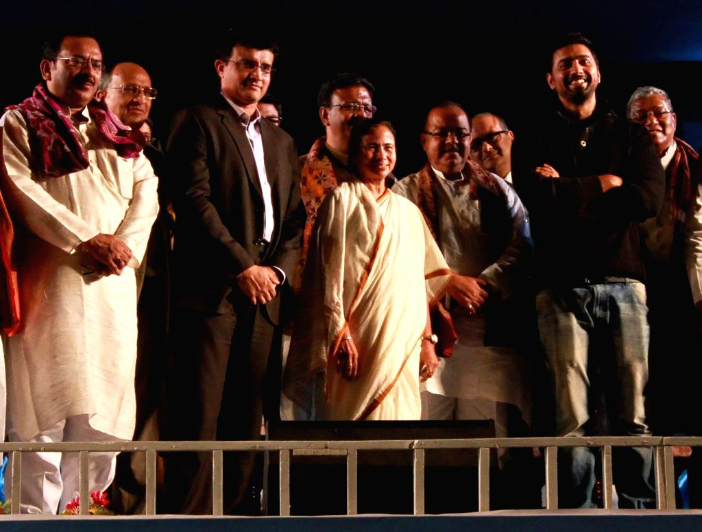 West Bengal Chief Minister Mamata Banerjee during a programme organised to lay the foundation stone of `Sourav Ganguly Cricket Academy`  in Kolkata, on Dec 1, 2014. Also seen former cricketer Sourav . - Amit Mitra, Arup Biswas and Abhishek Banerjee