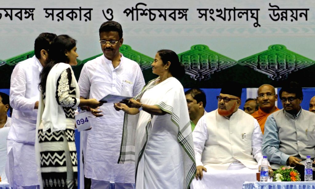 West Bengal Chief Minister Mamata Banerjee during a minority development programme in Kolkata on Aug 1, 2016. Also seen Firhad Hakim and Sultan Ahmed. - Mamata Banerjee