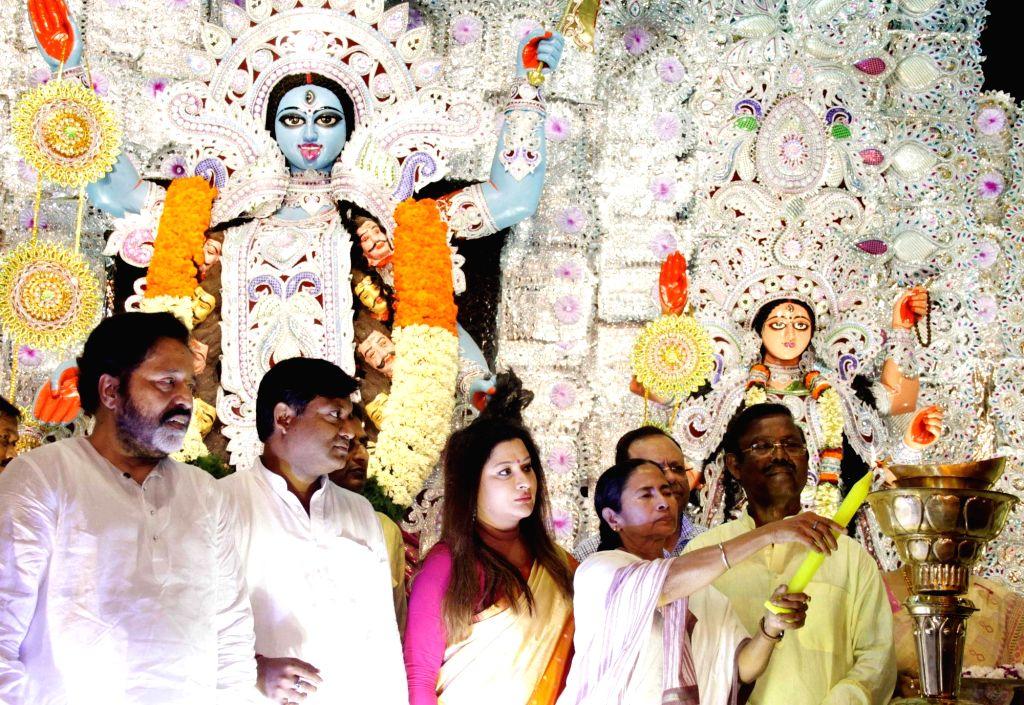West Bengal Chief Minister Mamata Banerjee during inauguration of a Kali Puja pandal in Kolkata, on Oct 26, 2016. - Mamata Banerjee