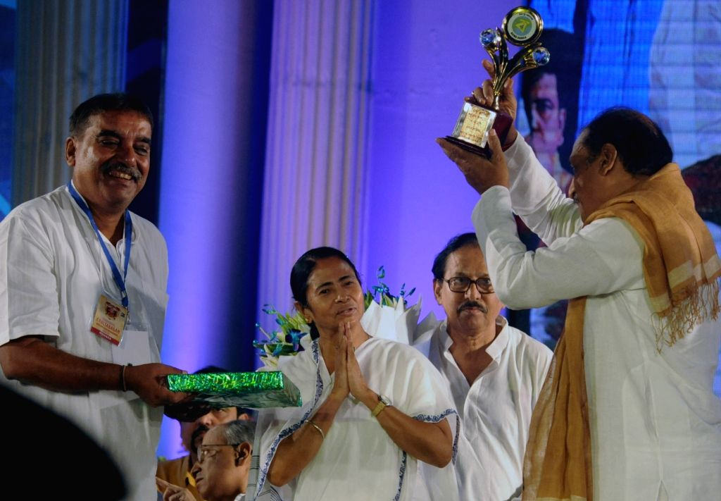 West Bengal Chief Minister Mamata Banerjee during Biswa Bangla Sharad Samman 2017 in Kolkata, on Oct 12, 2017. - Mamata Banerjee