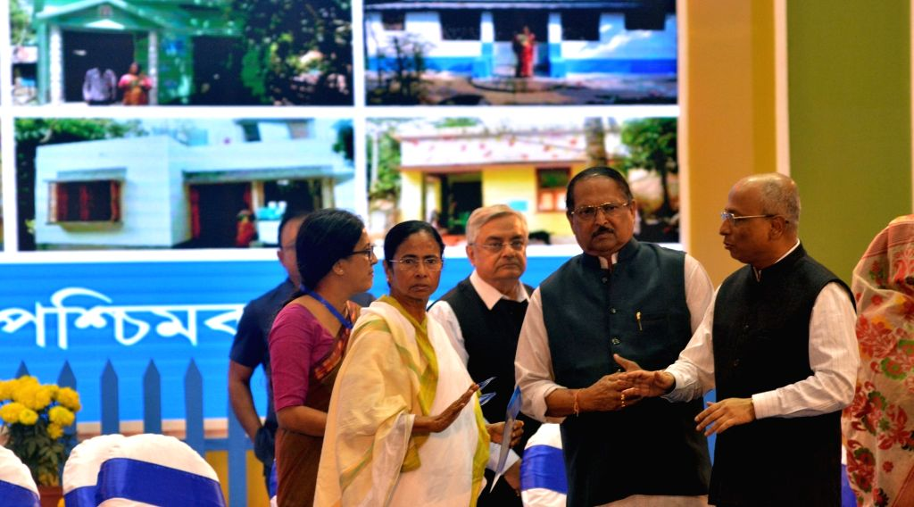 """West Bengal Chief Minister Mamata Banerjee during a programme organised to handover documents to the beneficiaries of """"Bengal Awas Yojana"""" scheme in Kolkata, on Jan 29, 2018. Also ... - Mamata Banerjee and Subrata Mukherjee"""