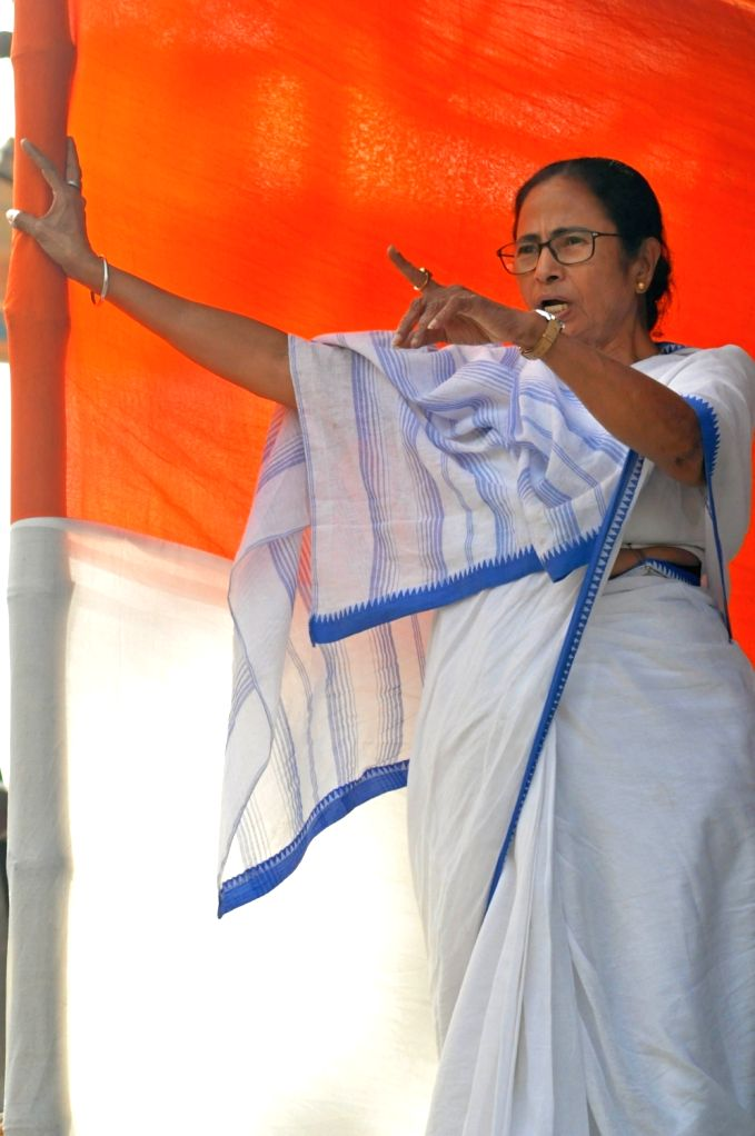 West Bengal Chief Minister Mamata Banerjee during a sit-in (dharna) demonstration over the CBI's attempt to question Kolkata Police Commissioner Rajeev Kumar in connection with a ponzi ... - Mamata Banerjee