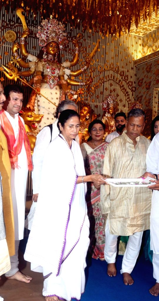 West Bengal Chief Minister Mamata Banerjee during inauguration of Chalta Bagan Durga Puja pandal in Kolkata on Sep 27, 2019. - Mamata Banerjee