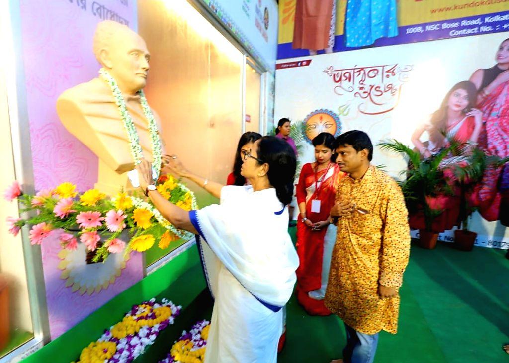 West Bengal Chief Minister Mamata Banerjee during inauguration of Naktala Udayan Sangha Durga Puja pandal in Kolkata on Sep 28, 2019. - Mamata Banerjee