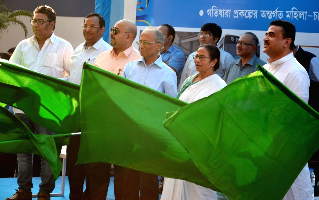 West Bengal Chief Minister Mamata Banerjee flags off green bus, electric bus and pink taxi at Nabanna, in Howrah on Feb 20, 2019. - Mamata Banerjee