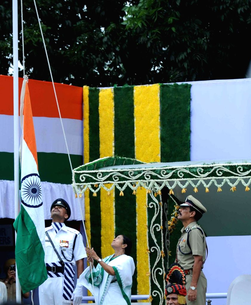 West Bengal Chief Minister Mamata Banerjee hoists the national flag during 68th Independence Day celebrations in Kolkata on Aug 15, 2014. Also seen Kolkata Police Commissioner Surojit Kar ...