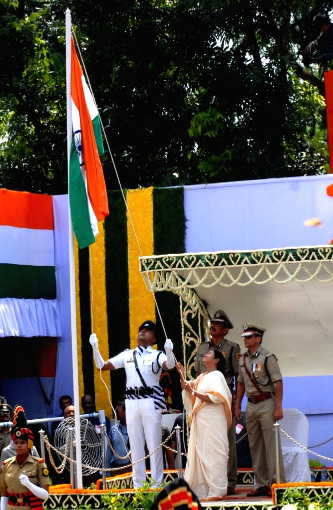 West Bengal Chief Minister Mamata Banerjee hoists the national flag on Independence Day at Red Road in Kolkata on Aug 15, 2016. - Mamata Banerjee
