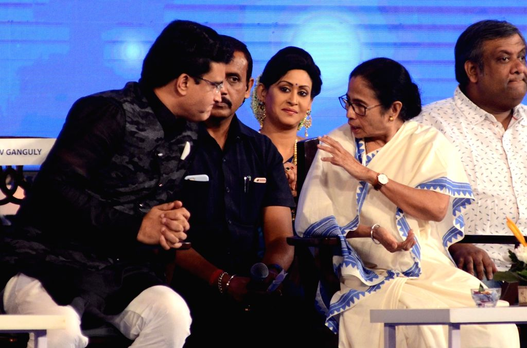 West Bengal Chief Minister Mamata Banerjee in a conversation with BCCI President Sourav Ganguly at the inaugural session of 25th Kolkata International Film festival, in Kolkata on Nov 8, ... - Mamata Banerjee and Sourav Ganguly