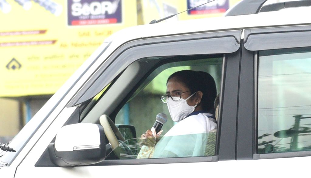 West Bengal Chief Minister Mamata Banerjee makes announcements and interacts with people as part of an awareness campaign against COVID-19 during the extended nationwide lockdown imposed to ... - Mamata Banerjee