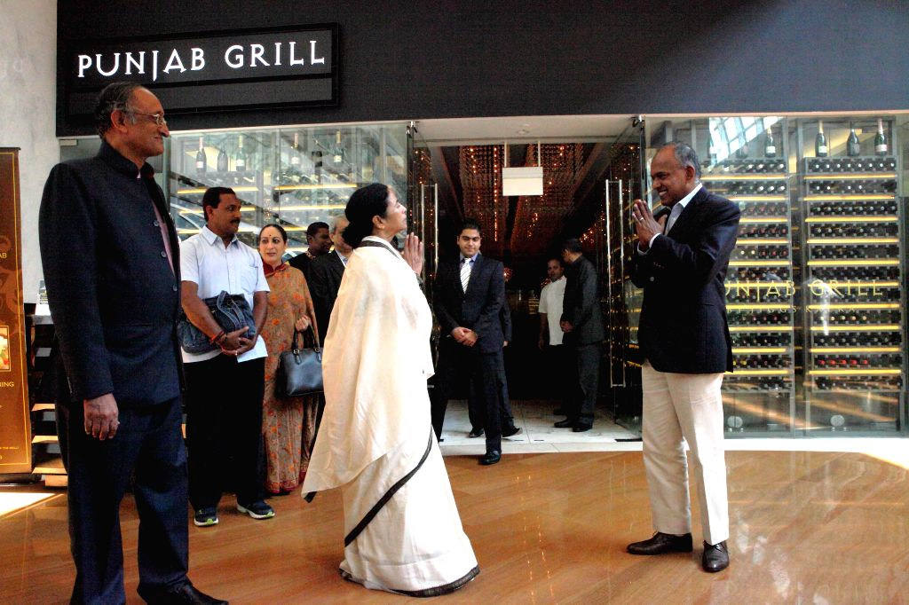 West Bengal Chief Minister Mamata Banerjee meets Foreign Minister of Singapore K Shanmugam in Singapore on Aug 21, 2014. Also seen West Bengal Finance Minister Amit Mitra.