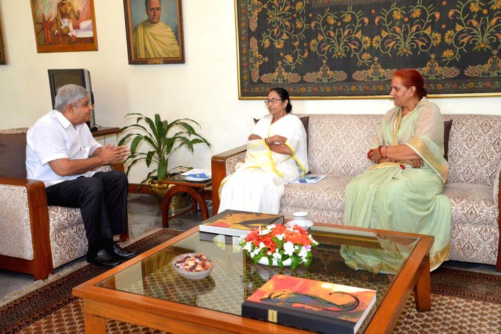 West Bengal Chief Minister Mamata Banerjee meets Governor Jagdeep Dhankhar at Raj Bhawan in Kolkata on Aug 9, 2019. - Mamata Banerjee