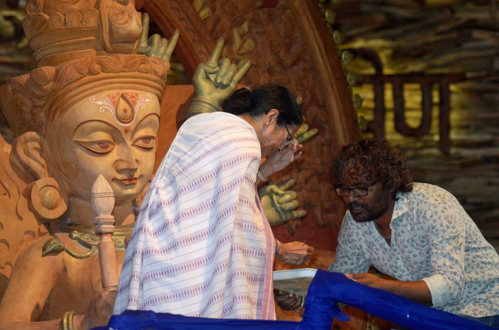 West Bengal Chief Minister Mamata Banerjee paints the eye of Durga idol in Kolkata on Sept 19, 2017. - Mamata Banerjee