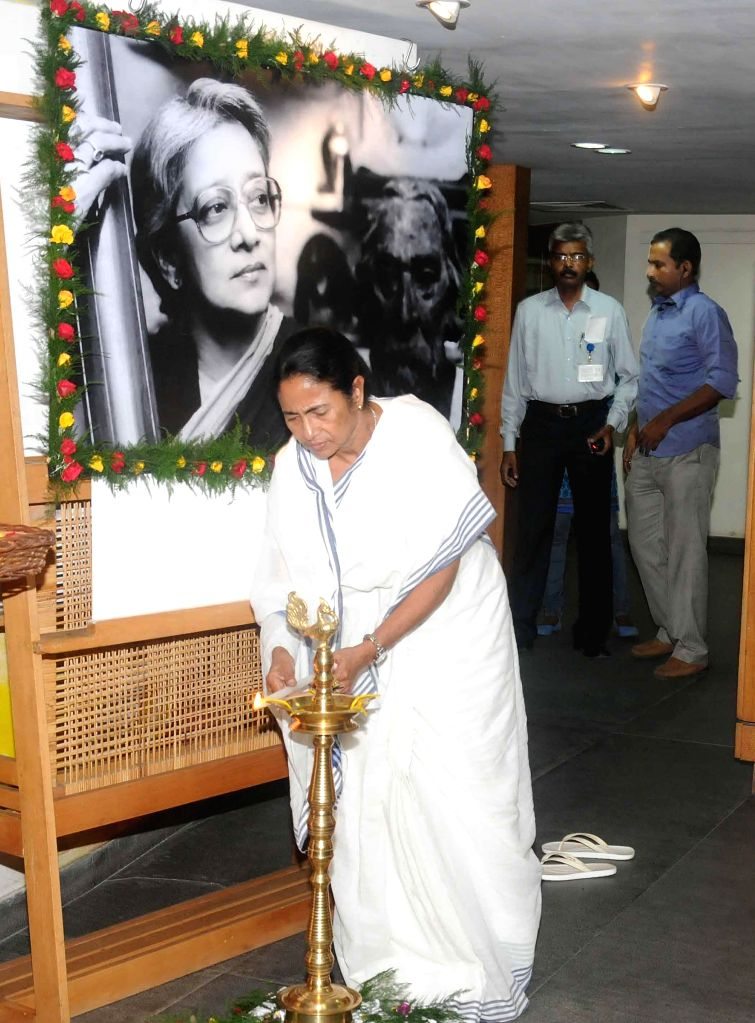 West Bengal Chief Minister Mamata Banerjee pays tribute to Rabindra Sangeet exponent Suchitra Mitra during a programme organised by Rabitirtho Praktoni in Kolkata on Sept 8, 2014. - Mamata Banerjee