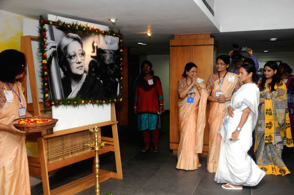 West Bengal Chief Minister Mamata Banerjee pays tribute to Rabindra Sangeet exponent Suchitra Mitra during a programme organised by Rabitirtho Praktoni in Kolkata on Sept 8, 2014. - Mamata Banerjee