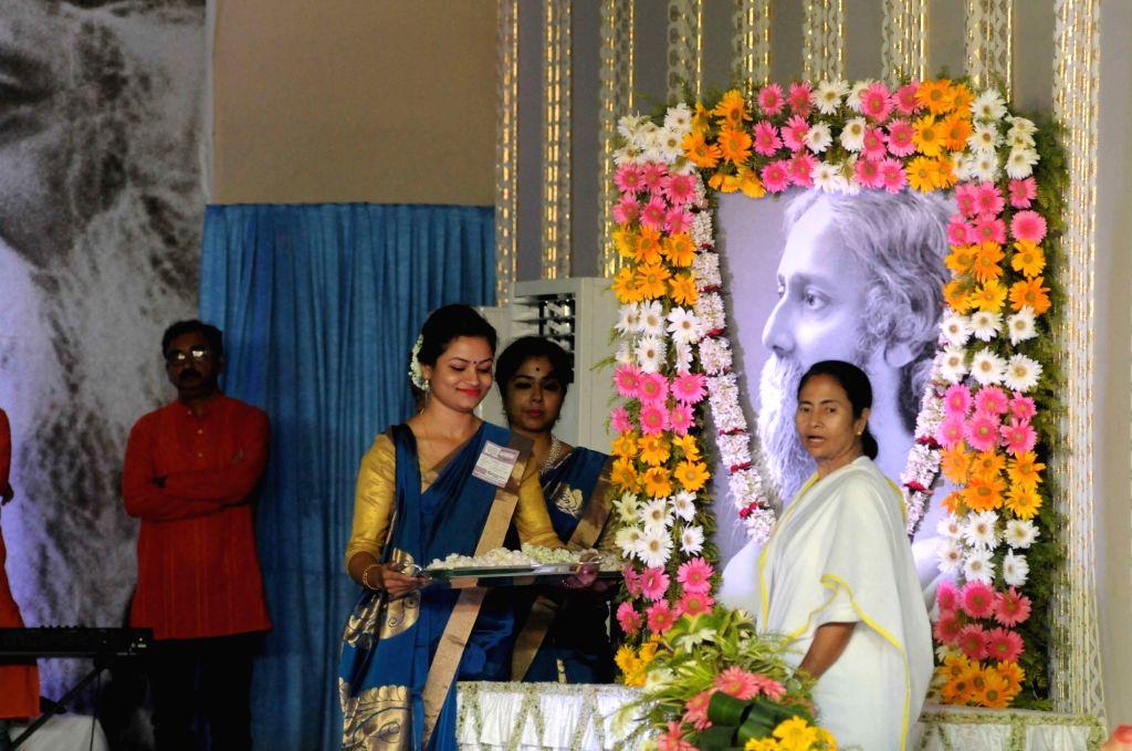 West Bengal Chief Minister Mamata Banerjee pays tribute to Gurudev Rabindranath Tagore on his birth anniversary in Kolkata on May 9, 2017. - Mamata Banerjee