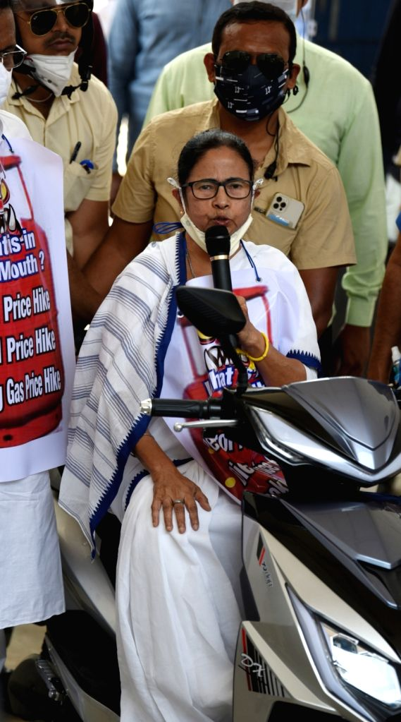West Bengal Chief Minister Mamata Banerjee riding scooty during protest rally against Central Government in Kolkata on Feb 25, 2021. - Mamata Banerjee