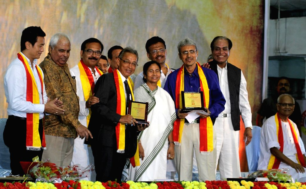 West Bengal Chief Minister Mamata Banerjee, Sports Minister Arup Biswas, Minister in Charge Municipal Affairs and Urban Development Department Firhad Hakim, former football player Shyamthapa ... - Mamata Banerjee