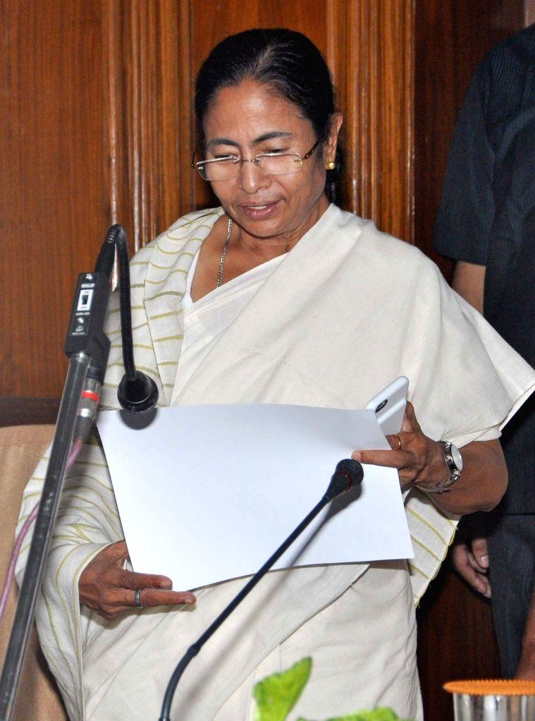 West Bengal Chief Minister Mamata Banerjee takes oath as a legislator at the West Bengal Assembly in Kolkata, on May 28, 2016. - Mamata Banerjee