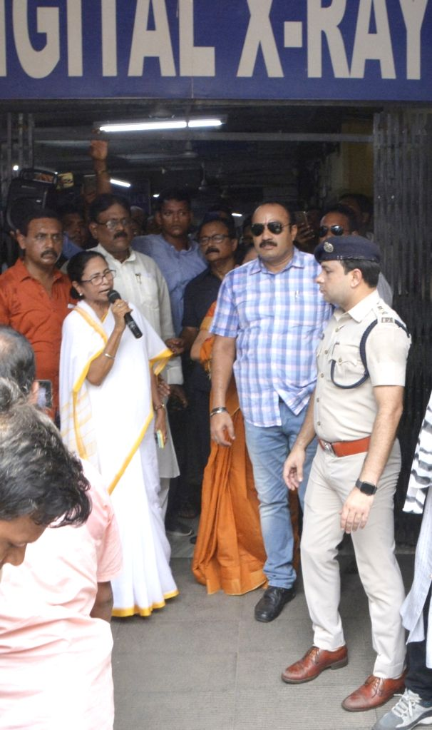 West Bengal Chief Minister Mamata Banerjee talks to the patients during her visit to the state-run Seth Sukhlal Karnani Memorial (SSKM) Hospital where the junior doctors held a strike since ... - Mamata Banerjee