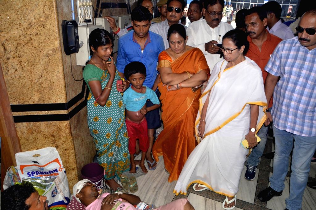 West Bengal Chief Minister Mamata Banerjee talks to the patients during her visit to the state-run Seth Sukhlal Karnani Memorial (SSKM) Hospital where the junior doctors held a strike since the last ... - Mamata Banerjee