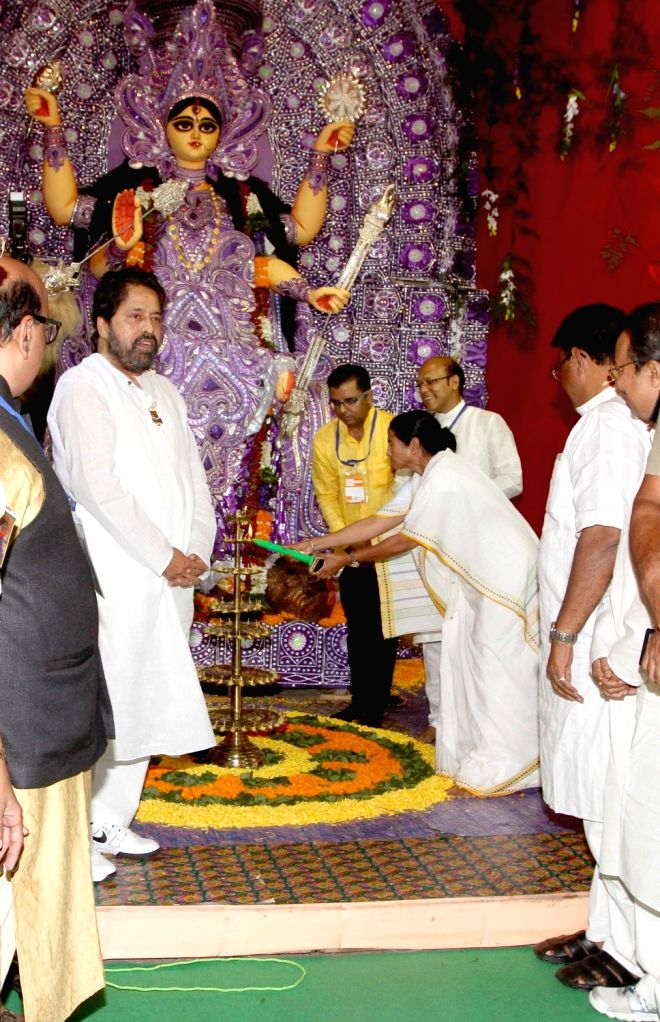 West Bengal Chief Minister Mamata Banerjee, TMC MP Sudip Banerjee inaugurate Jagadhatri puja pandal in Kolkata, on Nov. 16, 2015. - Sudip Banerjee