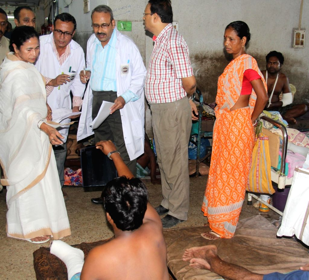 West Bengal Chief Minister Mamata Banerjee visits the victims who was injured during BJP rally, in Midnapore, on July 19, 2018. - Mamata Banerjee