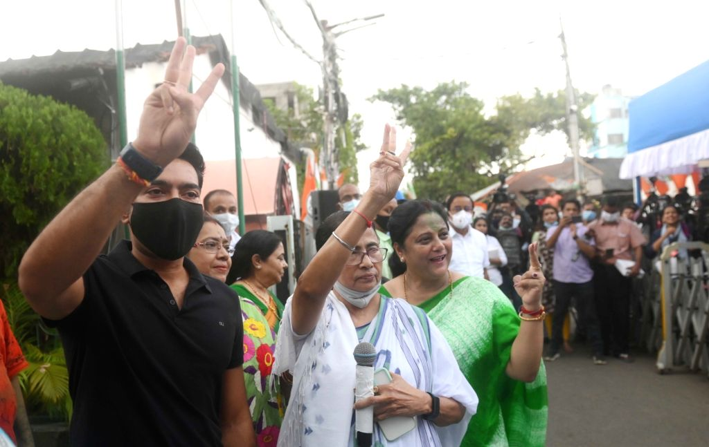 West Bengal Chief Minister Mamata Banerjee with Party General Secretary Abhishek Banerjee showing victory sign after winning bhawanipur by election in Kolkata on Sunday october 03, 2021. - Mamata Banerjee