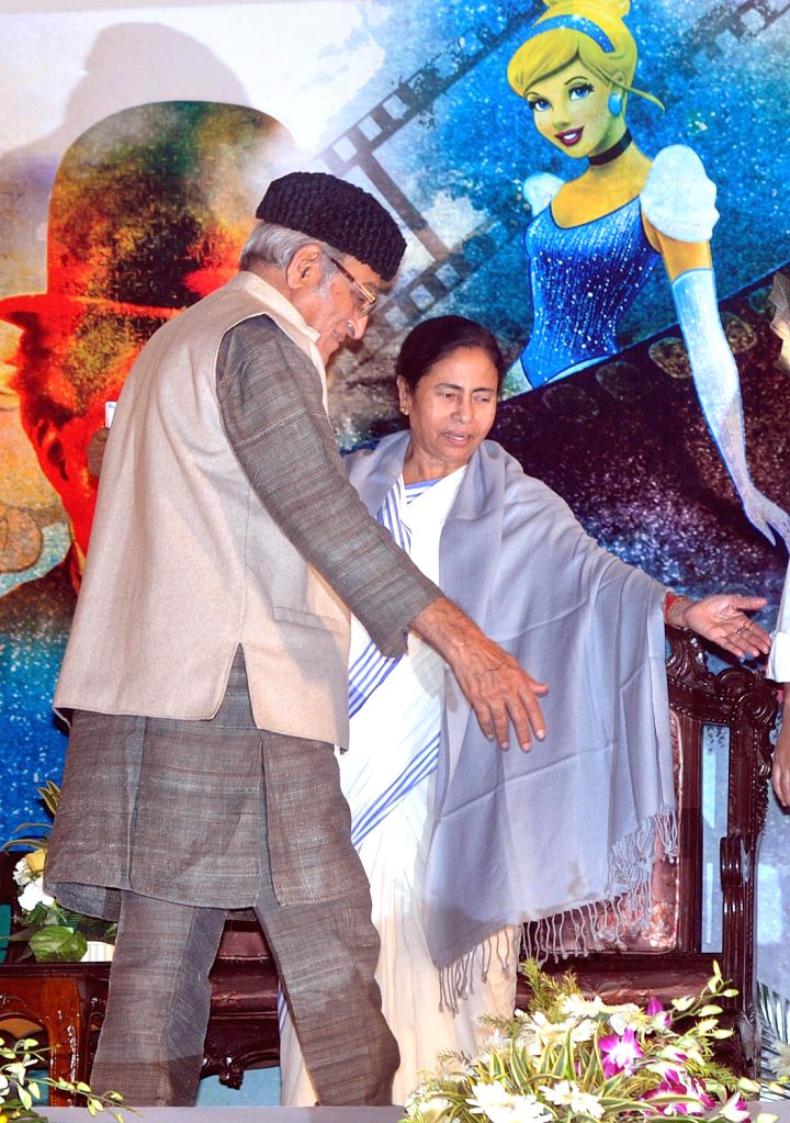 West Bengal Chief Minister Mamata Banerjee with Mohan Agashe during the 3rd Kolkata International Children's Film Festival in Kolkata on Dec.20, 2013.