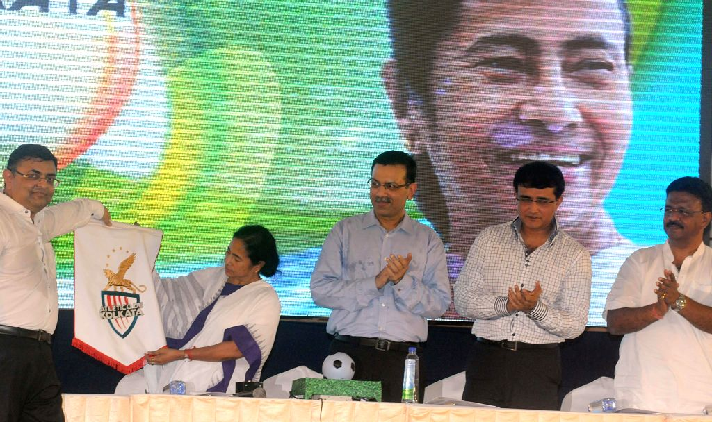 West Bengal Chief Minister Mamata Banerjee with Industrialist Sanjeev Goenka, former cricketer Sourav Ganguly and West Bengal Urban Development Minister Firhad Hakim during a programme organised to  . - Mamata Banerjee, Sourav Ganguly and Sanjeev Goenka