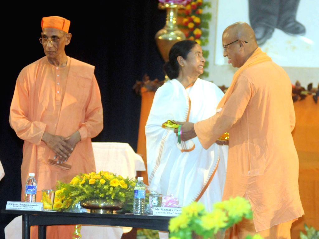 West Bengal Chief Minister Mamata Banerjee with Secretary of R.K Mission Institute of Culture, Swami Suparnananda (right) during a programme organised to commemorate Swami Vivekanand's Chicago ... - Mamata Banerjee