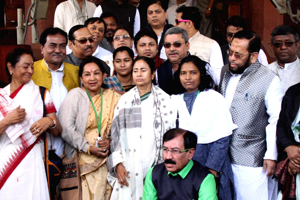 West Bengal Chief Minister Mamata Banerjee with Trinamool Congress MPs at the Parliament in New Delhi, on March 9, 2015.