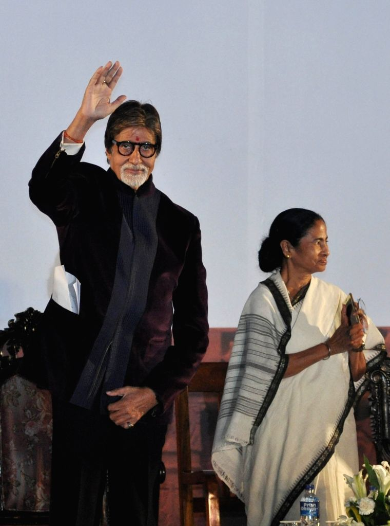 West Bengal Chief Minister Mamata Banerjee with actor Amitabh Bachchan during the inauguration of the 21st Kolkata International Film Festival in Kolkata on Nov 14, 2015. - Mamata Banerjee and Amitabh Bachchan
