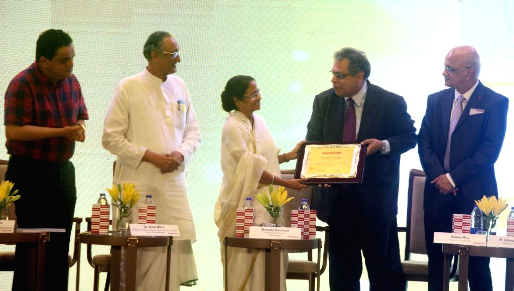 West Bengal Chief Minister Mamata Banerjee with Finance Minister Amit Mitra during Nasscom East IT Awards in Kolkata on July 6, 2017. - Mamata Banerjee