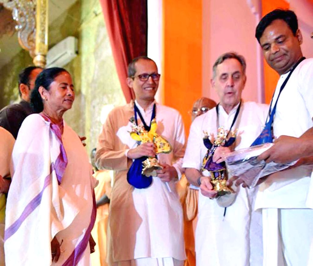 West Bengal chief Minister Mamata Banerjee with the great grand son of Henry Ford Alfred Ford during their visit to Isckon Temple in West Bengal's Nadia District on Feb 12, 2018. - Mamata Banerjee