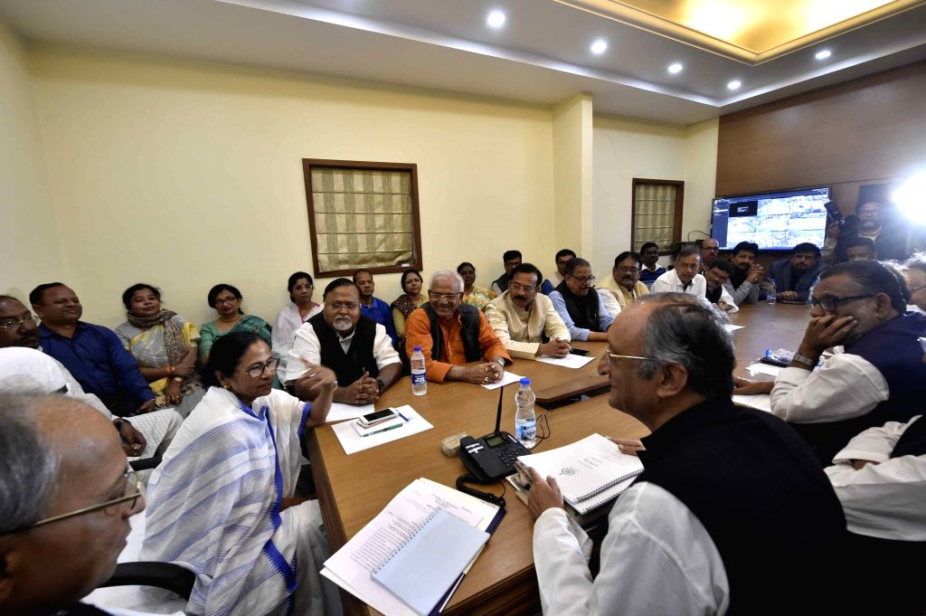 West Bengal Chief Minister Mamata Banerjee with Cabinet Ministers Amit Mitra, Partha Chatterjee, Aroop Biswas and others during a cabinet meeting in Kolkata, on Feb 4, 2019. - Mamata Banerjee, Amit Mitra, Partha Chatterjee and Aroop Biswas