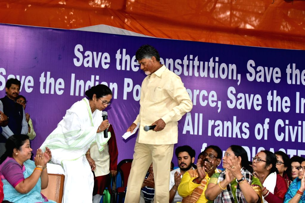 West Bengal Chief Minister Mamata Banerjee with Andhra Pradesh Chief Minister N. Chandrababu Naidu during her sit-in (dharna) demonstration over the CBI's attempt to question Kolkata Police ... - Mamata Banerjee and N. Chandrababu Naidu