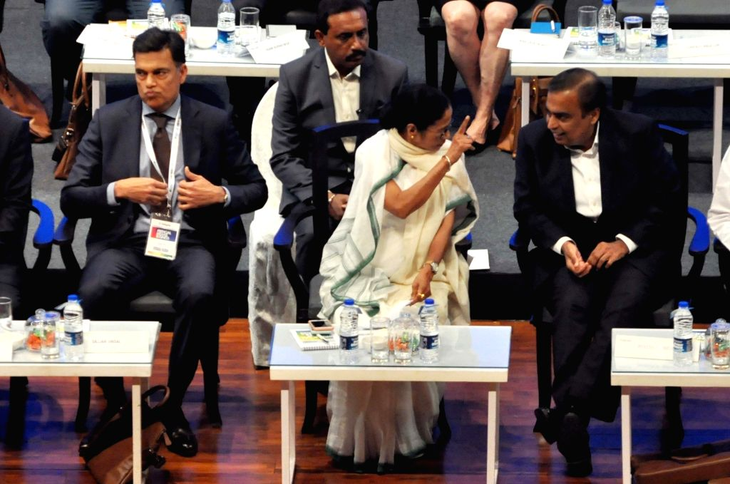 West Bengal Chief Minister Mamata Banerjee with Reliance Industries Chairman and Managing Director Mukesh Ambani and JSW Group Chairman Sajjan Jindal at Bengal Global Business Summit (BGBS) ... - Mamata Banerjee and Mukesh Ambani
