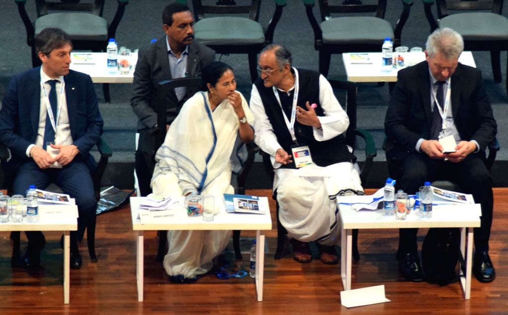 West Bengal Chief Minister Mamata Banerjee with state Finance Minister Amit Mitra at Bengal Global Business Summit (BGBS) 2019 in Kolkata, on Feb 8, 2019. - Mamata Banerjee