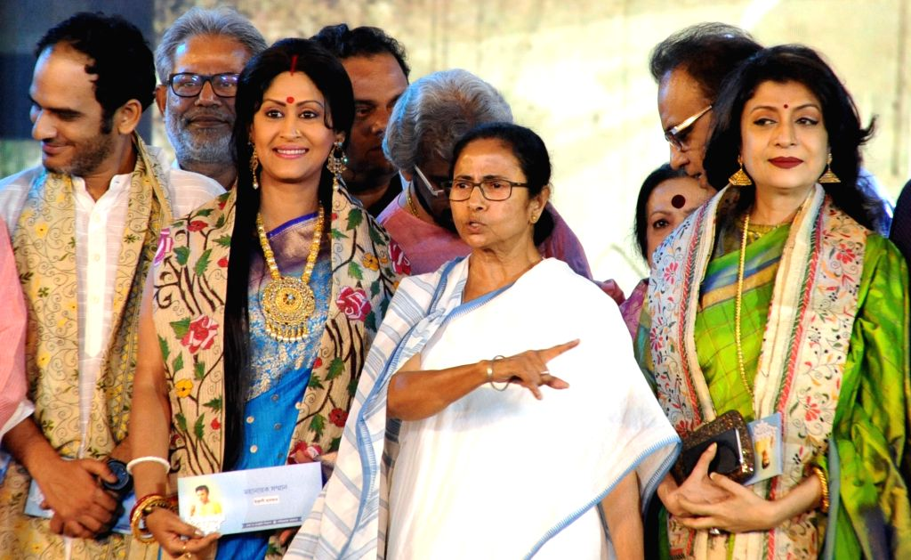 West Bengal Chief Minister Mamata Banerjee with actors Indrani Halder and Satabdi Roy during a programme organised on the death anniversary of actor Uttam Kumar, in Kolkata on July 24, 2019. - Mamata Banerjee, Indrani Halder, Satabdi Roy and Uttam Kumar